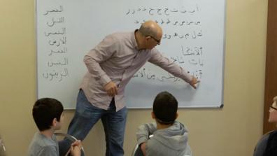 Instructor demonstrating Arabic script